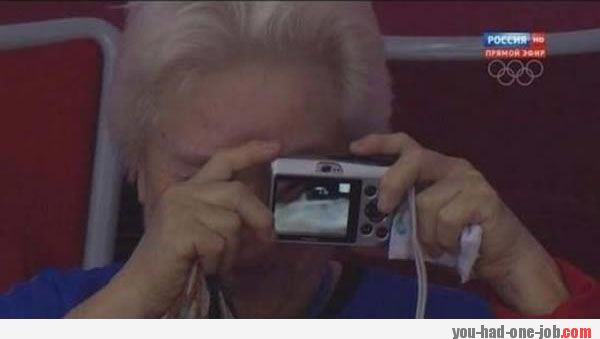 Old woman takes a selfie